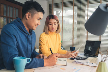 Young Asian Couple Managing Finances